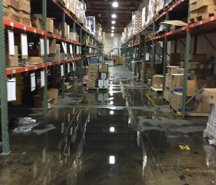 SEWAGE BACK-UP AT CITY OF INDUSTRY WAREHOUSE Before